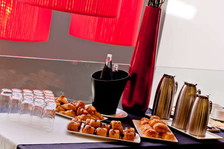 Bar table with an assortment of food and drink photo