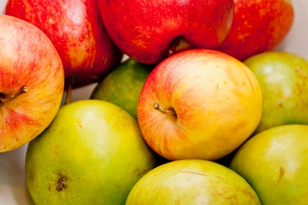 Apples of different colors and flavors stacked on each other Stock Photo
