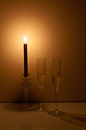 Champagne in the light of a candle creating a romantic environment for any celebration photo