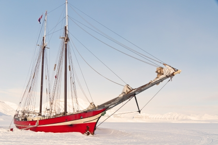 Ship run aground in the sea frozen in the island of svalvard in the Norwegian Arctic