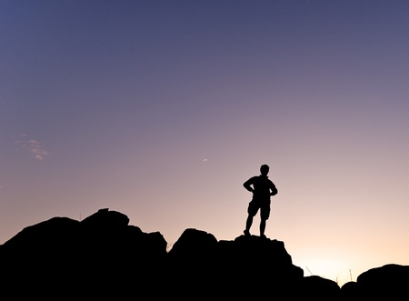 Man s silhouette in the high of a hill at the sunset - Horizontal Stock Photo - 16752015