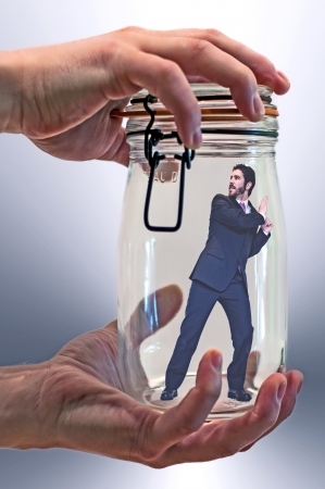 pent: businessman trapped in a glass jar - 2 Stock Photo