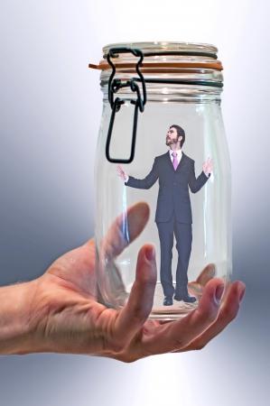 curledup: businessman trapped in a glass jar