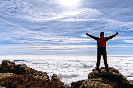 contemplates: Man in the high of the mountain filled with enthusiasm with the impressive panorama that he contemplates - 2