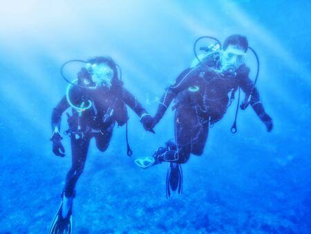buddies: Couple enjoys scuba diving under the sea