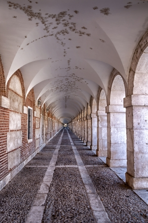 Hall perspective of columns and arches in the palace of Aranjuez