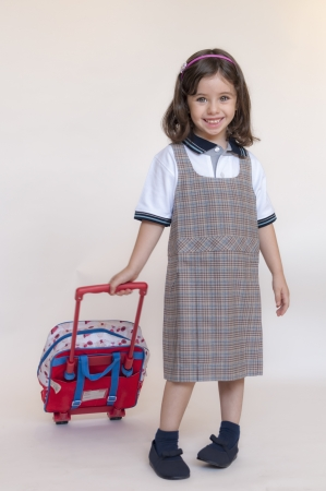 Girl poses with the school uniform ready to go back to school