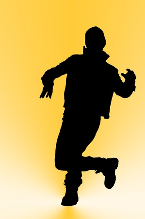 Silhouette of man dancing hip hop  photo