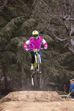 Extreme jump on a bike in forest during competition downhill