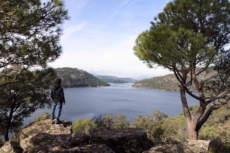 Man contemplates from the top the dam of San juan, Madrid, Spain Banco de Imagens