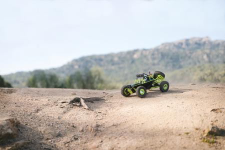 砂の上の無線制御車。クローズ アップ 写真素材
