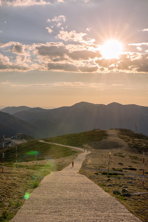 trip over: Hikers walking on a mountain at sunset in Navacerrada, Madrid. Spain