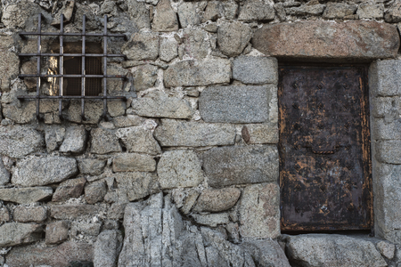 Old wall and the front door in the medieval castle