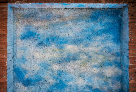Blue sky and clouds over brick wall texture or background Stock fotó