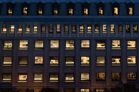 Office building facade at night