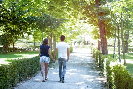 Young couple in love enjoying a sunny day in the park