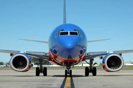 Commercial airplane pulling at the gate photo