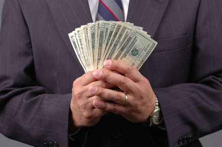 Cash in hands by a businessman. Stock Photo - 519155