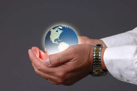 Earth been held in hands with a neutral background Stock Photo - 519152