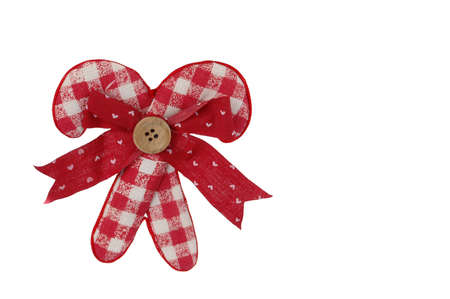 Christmas canes and bow in white background