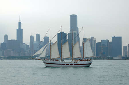 Chicago Skyline with Sailboat on a cloudy day Stock Photo