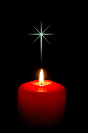 christmas religious: Christmas candle with cross and black background