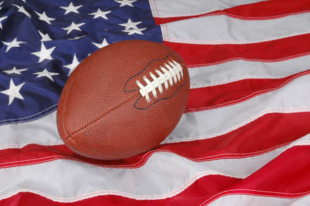 pigskin: American Football with flag in background