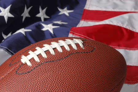 he: Football with the American Flag in he background
