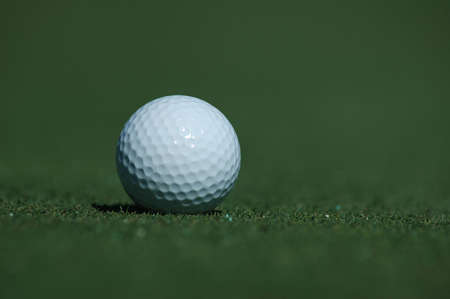 Close up of a golf ball on the course photo