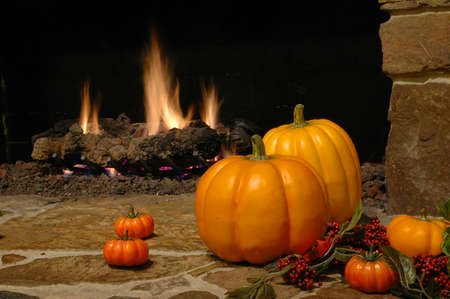 pumkin: Pumkins at the fire place Stock Photo