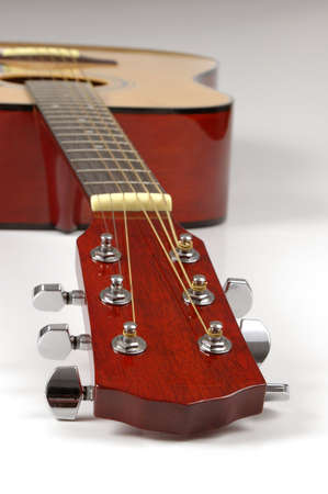 Guitar in pesrpective with shallow DOP on neutral background Stock Photo