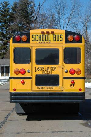 School bus in the neighborhood showing the back