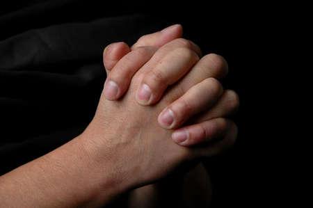 Hands in prayer on dark background Stock Photo - 1124992