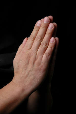 Hands in prayer on dark background Stock Photo - 1124993