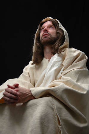 Jesus portrait in prayer with black background Stock Photo - 1124997