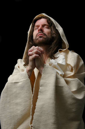 black jesus: Portrait of Jesus in prayer with dark background