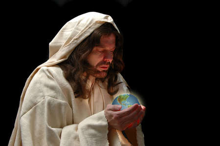 Portrait of Jesus holding the world with dark background photo