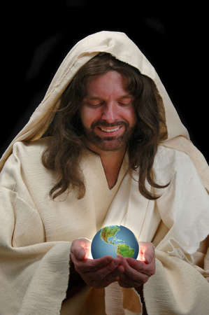 heaven on earth: Portrait of Jesus holding the world with dark background