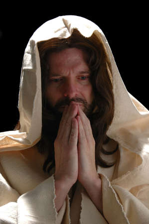 Portrait of Jesus in prayer with dark background photo