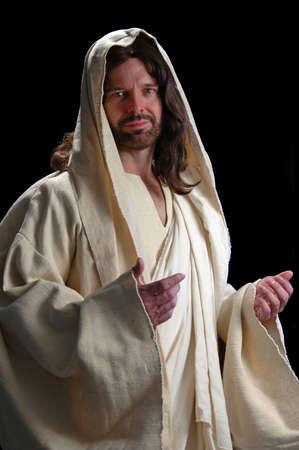 Portrait of Jesus with gentle look on dark background