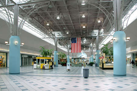shop interior: Inside a mall with american flag Stock Photo