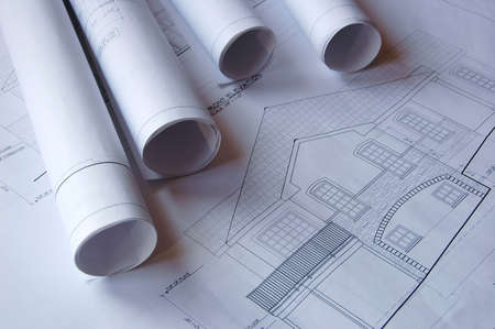 Blueprints of a house and rolls Stock Photo