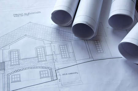 Blueprints of a house and rolls photo