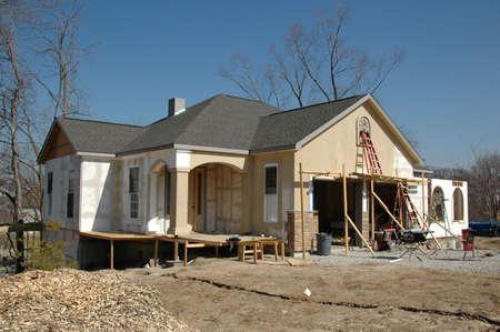 House under construction against blue sky photo