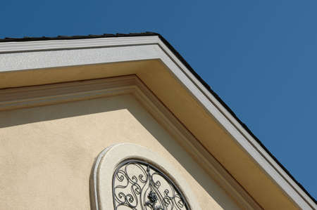 cladding tile: House roof top against blue sky