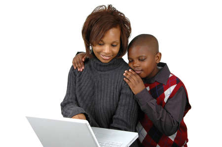 on lap: Mother and son looking at a computer against white background