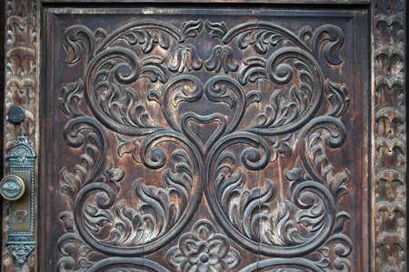 entranceway: Detail of old door carved by hand showing spanish colonial design