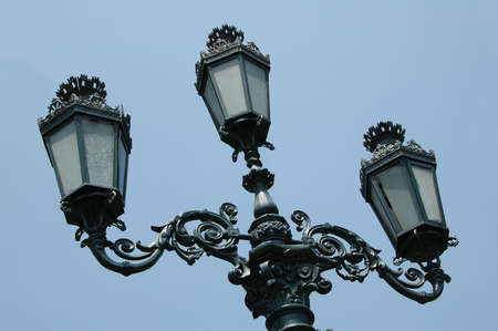 Street lamp in downtown Lima Peru against blue sky
