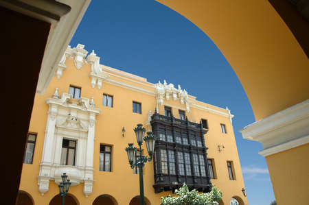 View of downtown Lima Peru with colonial  balcony and street lamp against blue sky Stock Photo