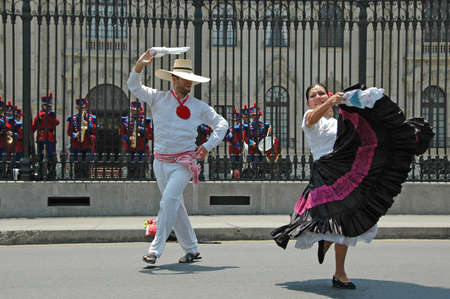 lima: Marinera dancers in front of the goberment palace in Lima Peru Stock Photo